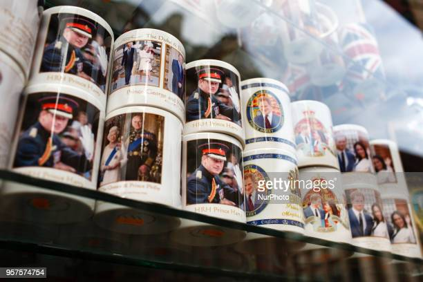 Souvenir mugs of Britain's Prince Harry stand on display in a shop window near Piccadilly Circus ahead of the muchanticipated wedding of Harry to...