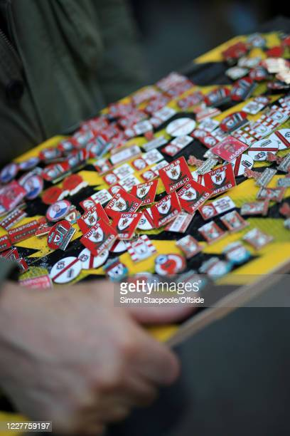 Souvenir pins and badges for sale at Anfield on July 22, 2020 in Liverpool, England.