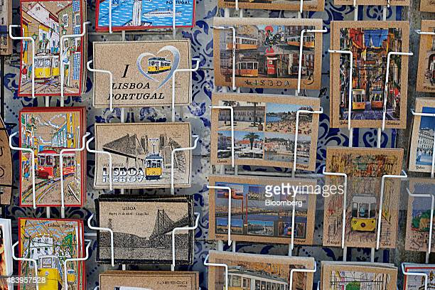 Souvenir postcards sit on display outside a tourist store in Lisbon Portugal on Sunday July 26 2015 Lisbon is joining other European cities like...