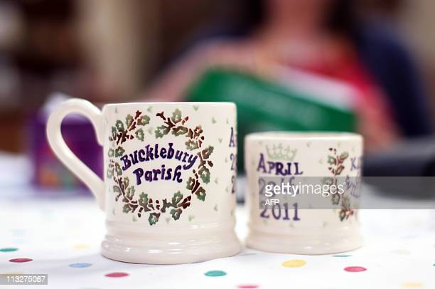 Souvenir royal wedding mugs sit on display at a Tea in the Park event in Kate Middleton's home village of Bucklebury on April 29 2011 AFP PHOTO /...