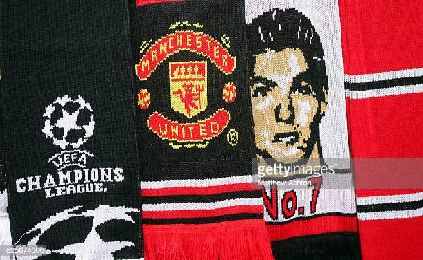 Souvenir scarves on sale outside Old Trafford prior to the UEFA Champions League Final in Moscow showing logos and Cristiano Ronaldo