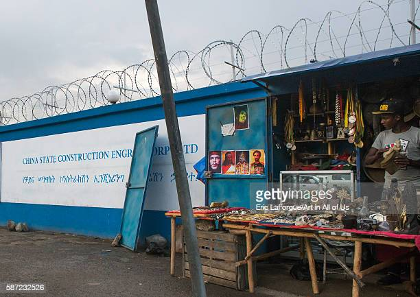 Souvenir seller near a construction site for new building with chinese cooperation addis abeba region addis ababa Ethiopia on March 7 2016 in Addis...