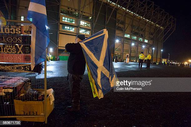 A souvenir seller with saltire flags for sale outside the stadium before the European Championship qualifying match between Scotland and the Republic...