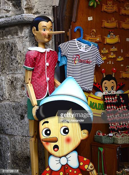 A souvenir shop in the medieval walled hill town of San Gimignano in the Tuscany region of Italy sells merchandise related to Pinocchio the fictional...