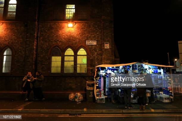 Souvenir stall lit up by street lamps on Gwladys Street ahead of the Premier League match between Everton and Watford at Goodison Park on December...