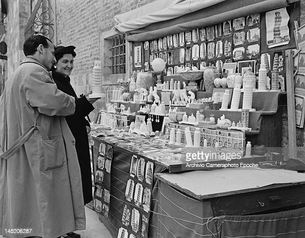 A souvenir stall selling models of the Leaning Tower of Pisa Italy circa 1950