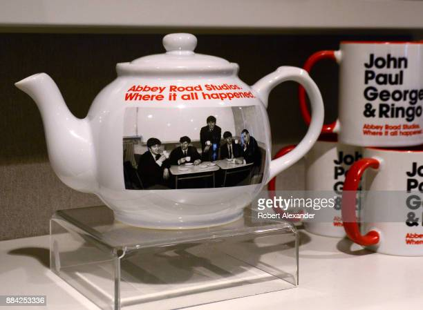 Souvenir teapots and mugs are among the Beatlesrelated items for sale at Abbey Road Shop located near Abbey Road Studios in London England formerly...