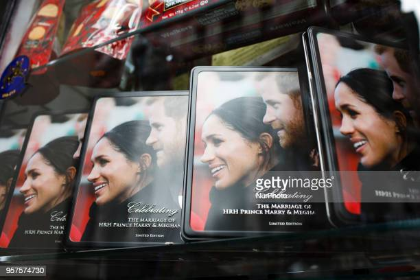 Souvenir tins stand on display in a shop window near Piccadilly Circus ahead of the muchanticipated wedding of Britain's Prince Harry to former US...