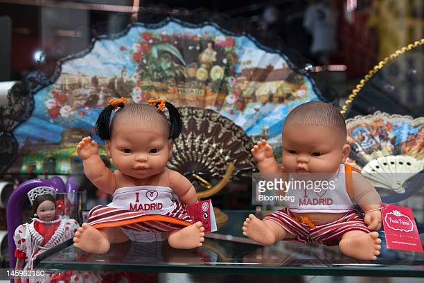 Souvenir toy dolls wearing I love Madrid tops stand for sale on a shelf in a tourist store in Madrid Spain on Friday June 8 2012 Spain is poised to...