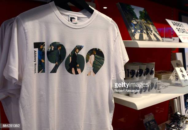 Souvenir T-shirts and mugs are among the Beatles-related items for sale at Abbey Road Shop, located near Abbey Road Studios in London, England,...