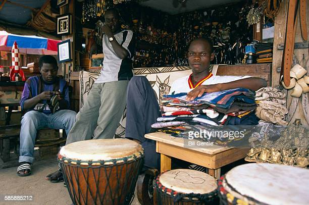souvenir vendors at stand - freetown sierra leone stock pictures, royalty-free photos & images