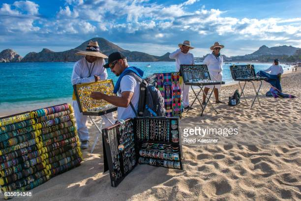 Souvenir vendors sell their wares to tourists on the beach at Playa El Medano, Cabo San Lucas.