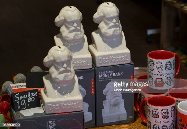 Souvenirs around the topic Karl Marx in Trier portrait busts of the philosoper as a money box and drinking cups