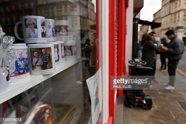 Souvenirs depicting members of Britain's Royal Family, are pictured in a shop, closed due to Covid-19, near Windsor Castle in Windsor, west of...