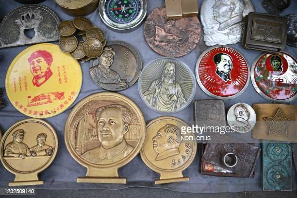 Souvenirs depicting the late Chinese Communist leader Mao Zedong are seen at a stall in the Panjiayuan antique market in Beijing on April 25, 2021.