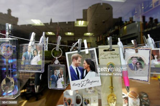 Souvenirs featuring Britain's Prince Harry and his fiance US actress Meghan Markle are displayed in a gift shop on May 3 2018 in Windsor England St...