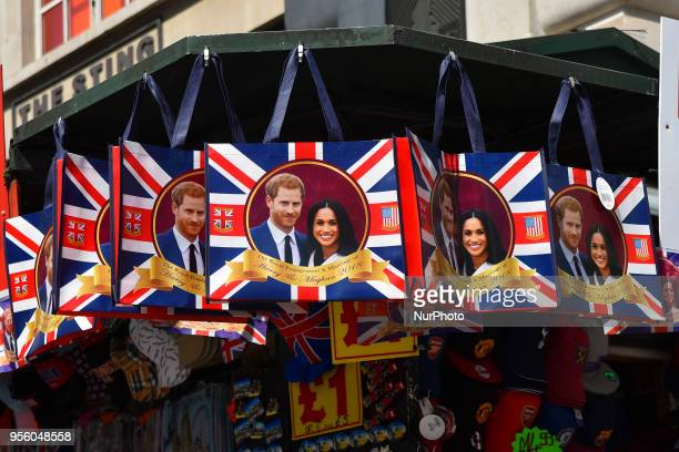 Souvenirs featuring Britain's Prince Harry and his fiance US actress Meghan Markle in a gift shop in Central London on May 8 2018 St George's Chapel...