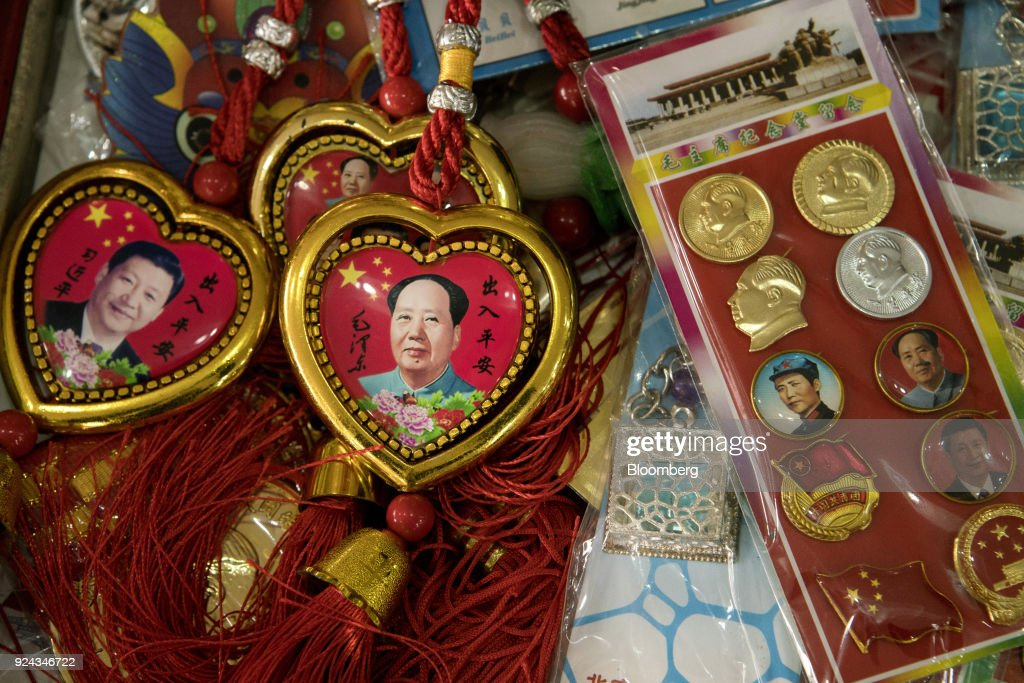 Souvenirs featuring portraits of Chinese PresidentXi Jinping, left, and former Chinese leader Mao Zedong sit on display in Beijing, China, on Monday, Feb. 26, 2018. China's Communist Party is set to repeal presidential term limits in a move that would allowXi to rule beyond 2023, completing the country's departure from a political system based on collective leadership. Photographer: Giulia Marchi/Bloomberg via Getty Images