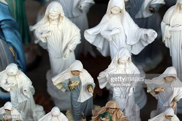 Souvenirs featuring the statue of the Virgin Mary are sold at one of the sites of the Marian apparitions on March 6 2014 in Medjugorje Bosnia and...