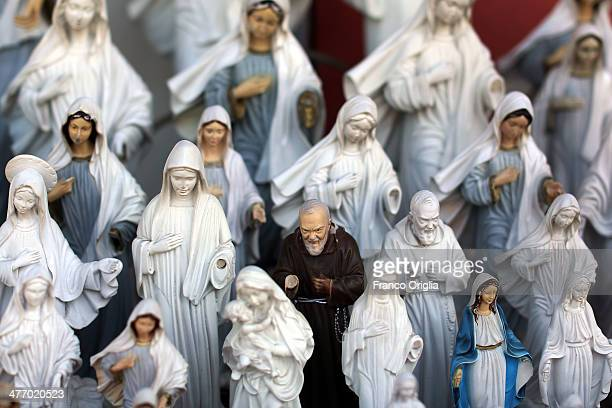 Souvenirs featuring the statues of Virgin Mary and of Padre Pio are sold at one of the sites of the Marian apparitions on March 6 2014 in Medjugorje...