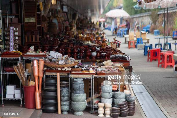 souvenirs for sale at market stall - jeonju stock photos and pictures