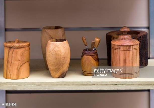 Souvenirs made of olive wood displayed in a gift shop