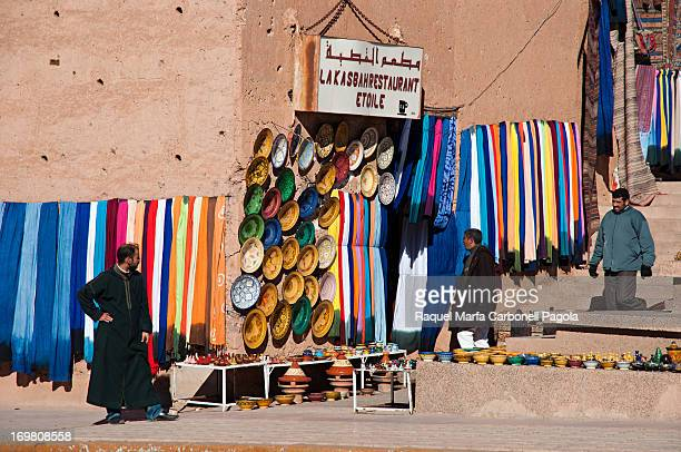 Souvenirs shops in a traditional adobe building in front of Kasbah Taourirt, Ouarzazate, Morocco, 2012
