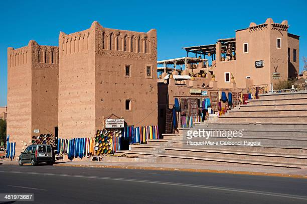 Souvenirs shops in a traditional adobe building in front of Kasbah Taourirt.