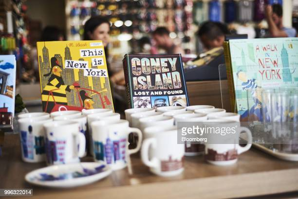 Souvenirs sit on display for sale at a store on the Coney Island boardwalk in the Brooklyn Borough of New York US on Saturday July 7 2018 Bloomberg...