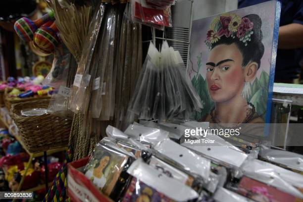 Souvenirs with the image of the Mexican artist Frida Kahlo are seen during the Frida Kahlo's 110th birthday anniversary at the Coyoacan's market on...