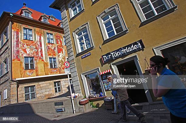 Souvenirshop in front of the former City Hall at the river Regnitz with its facade in rococo style on June 11 2009 in Bamberg Germany Bamberg is...