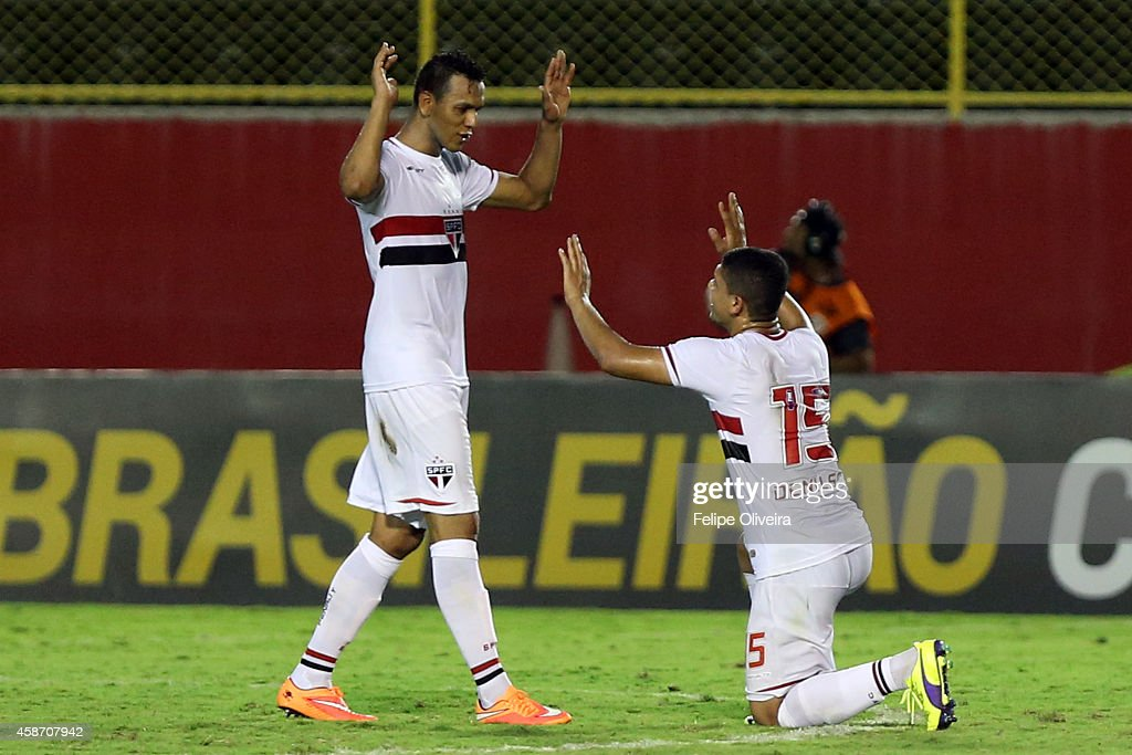 Souza (L) and Denilson of Sao Paulo celebrates the victory against Vitoria the before match between Vitoria and Sao Paulo as part of Brasileirao Series A 2014 at Estadio Manoel Barradas on November 9, 2014 in Salvador, Bahia, Brazil.