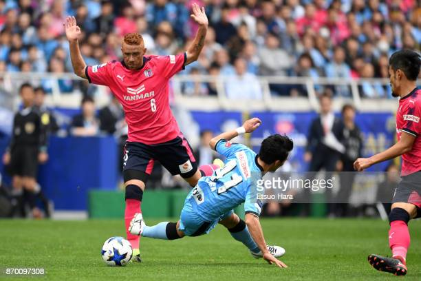 Souza of Cerezo Osaka and Akihiro Ienaga of Kawasaki Frontale compete for the ball during the JLeague Levain Cup final match between Cerezo Osaka and...