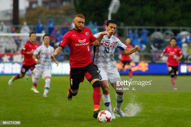 Souza of Cerezo Osaka and Dudu of Ventforet Kofu compete for the ball during the JLeague J1 match between Cerezo Osaka and Ventforet Kofu at Kincho...