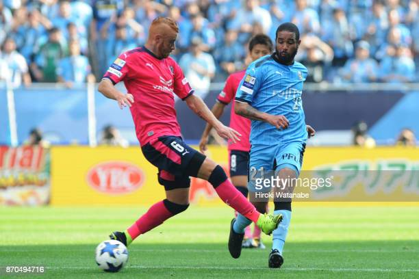 Souza of Cerezo Osaka and Eduardo Neto of Kawasaki Frontale compete for the ball during the JLeague Levain Cup final match between Cerezo Osaka and...