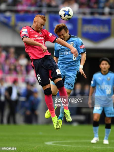 Souza of Cerezo Osaka and Hiroyuki Abe of Kawasaki Frontale compete for the ball during the JLeague Levain Cup final match between Cerezo Osaka and...