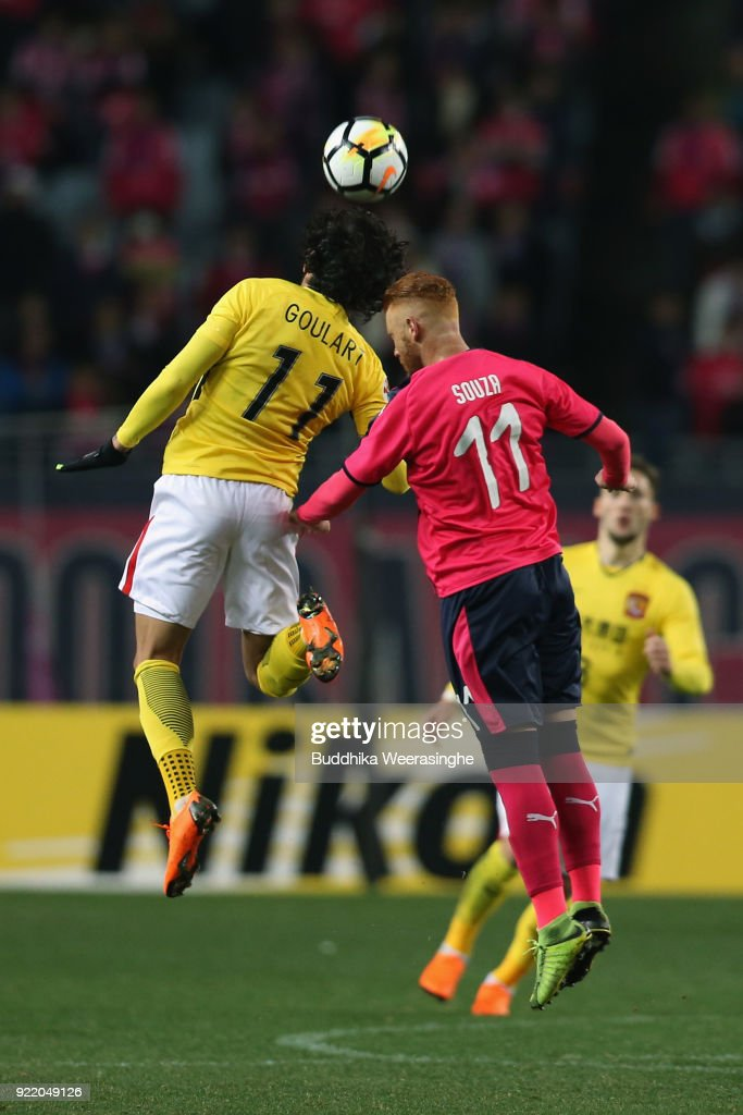 Souza of Cerezo Osaka and Ricardo Goulart of Guangzhou Evergrande compete for the ball during the AFC Champions League Group G match between Cerezo Osaka and Gunazhou Evergrande at the Yanmar Stadium Nagai on February 21, 2018 in Osaka, Japan.