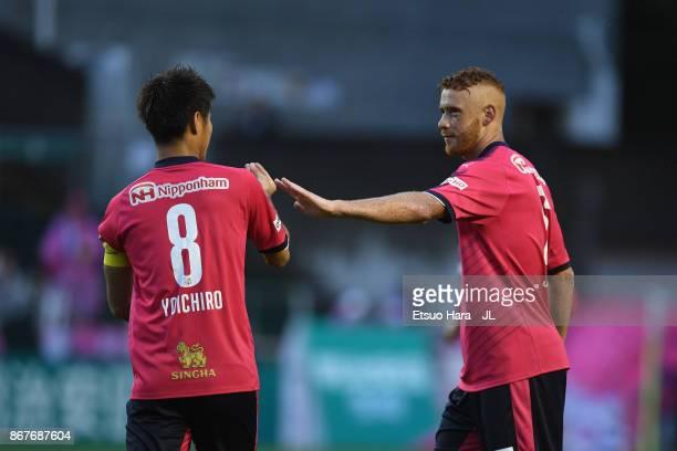 Souza of Cerezo Osaka celebrates scoring the opening goal with his team mate Yoichiro Kakitani during the JLeague J1 match between Cerezo Osaka and...