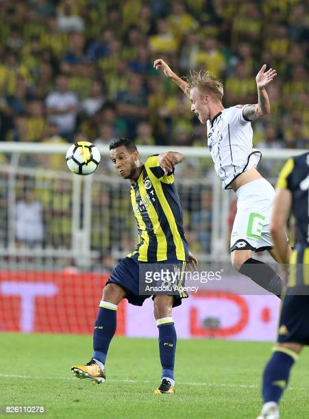 Souza of Fenerbahce in action against Peter Zuji of Sturm Graz during the UEFA Europa League third qualifying round 2nd leg match between Fenerbahce...