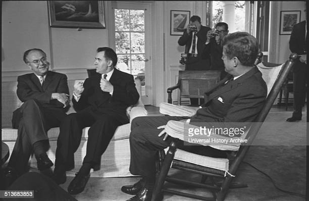 Soviet ambassador to the US Anatoly F Dobrynin and Soviet foreign minister Andrei Gromyko talking with President Kennedy who is seated in rocking...
