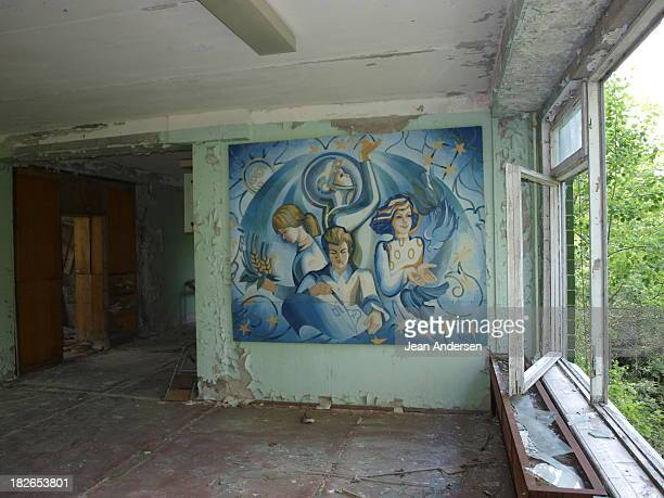 Soviet art on the wall of High school No.2 in the abandon city Pripyat.