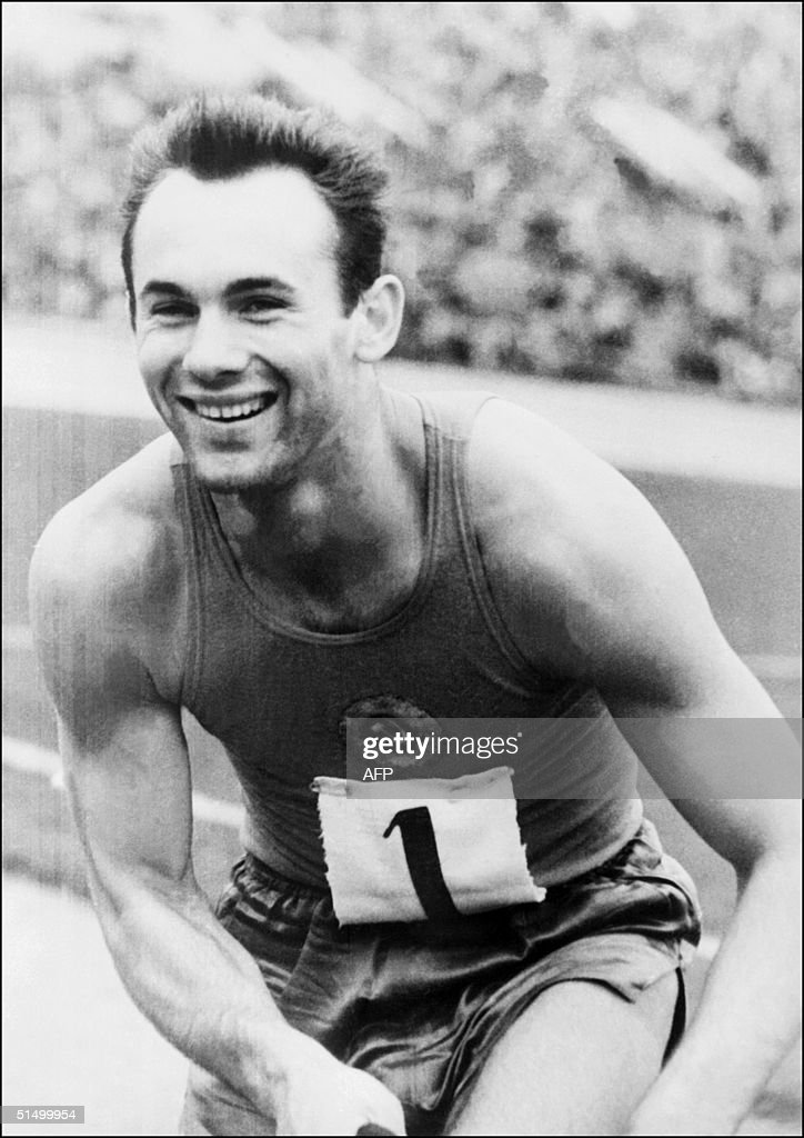 Soviet athlete Valery Brumel smiles as he just set : News Photo