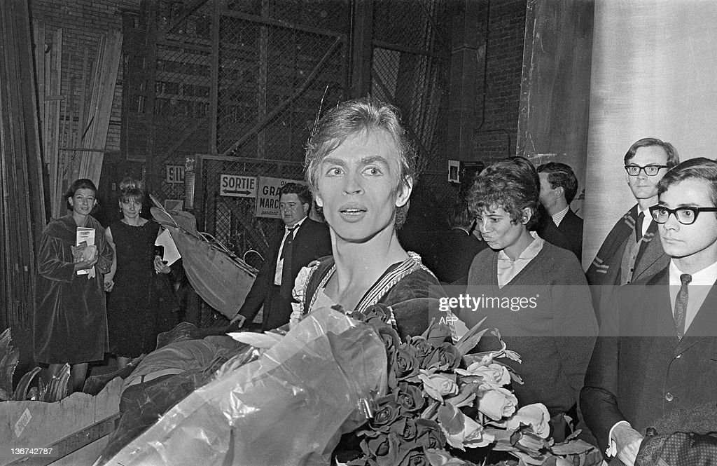 Soviet born dancer Rudolf Nureyev receives flowers after his interpretation of 'Swan lake' during the opening of International Dance Festival at the Champs-Elysees theater in Paris on November 6, 1963.
