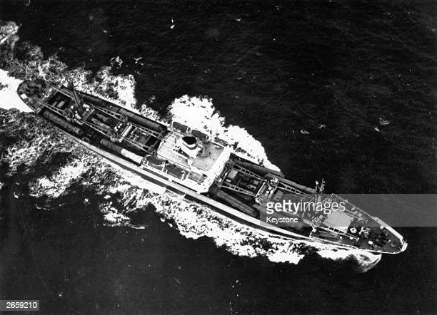 Soviet cargo ship with eight missile transporters and canvas-covered missiles lashed on deck during its return voyage from Cuba to the Soviet Union....