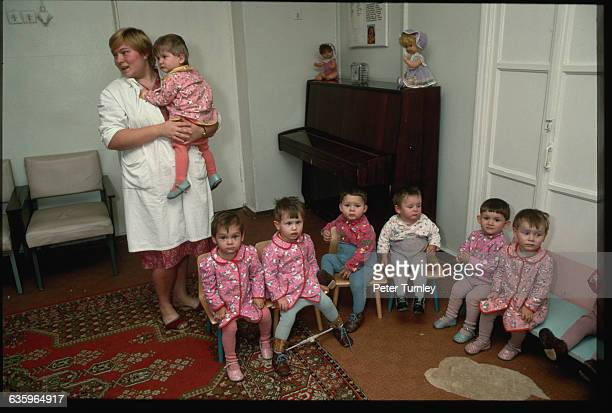 A Soviet child care worker with orphans in an orphanage during an economic depression in Tula USSR   Location Tula USSR