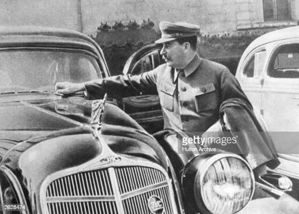 Soviet Communist leader Joseph Stalin adjusting the windscreen wipers on his car