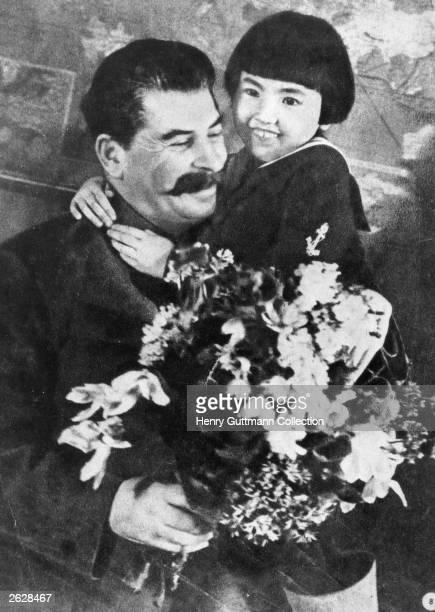Soviet Communist leader Joseph Stalin with Galia Markifova at a reception for the elite of the workers of the Biviato autonomous socialist republic...