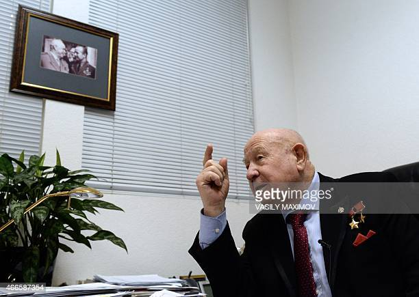 Soviet cosmonaut Alexei Leonov who was the first man to walk in space on March 18 gestures during his interview with AFP in Moscow on March 16 2015...