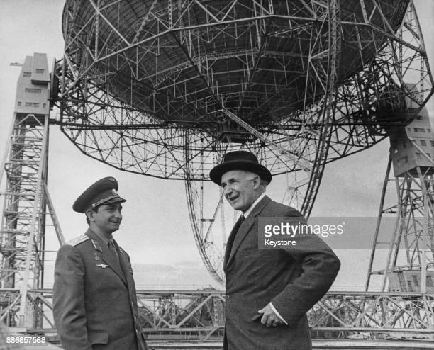 Soviet cosmonaut Valery Bykovsky with England radio astronomer Sir Bernard Lovell during a visit to the Jodrell Bank Observatory UK to see the giant...