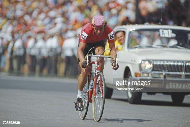 Soviet cyclist Sergei Sukhoruchenkov pictured in action during competition to cross the finish line in first place to win the gold medal for the...